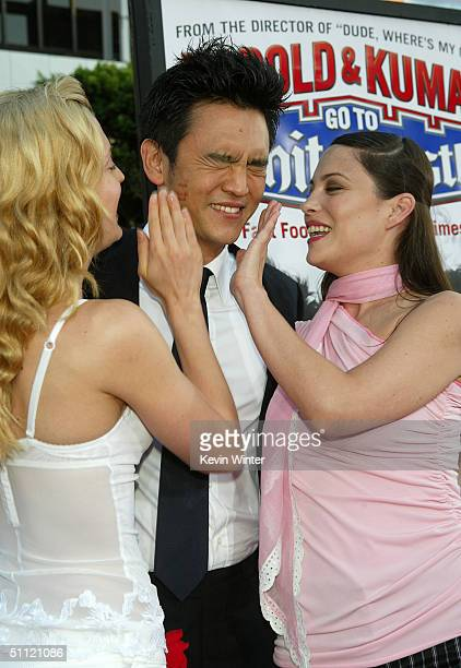 Actors Brooke D'Orsay John Cho and Kate Kelton arrive at the World Premiere of Harold Kumar Go to White Castle at the Grauman's Chinese Theatre on...