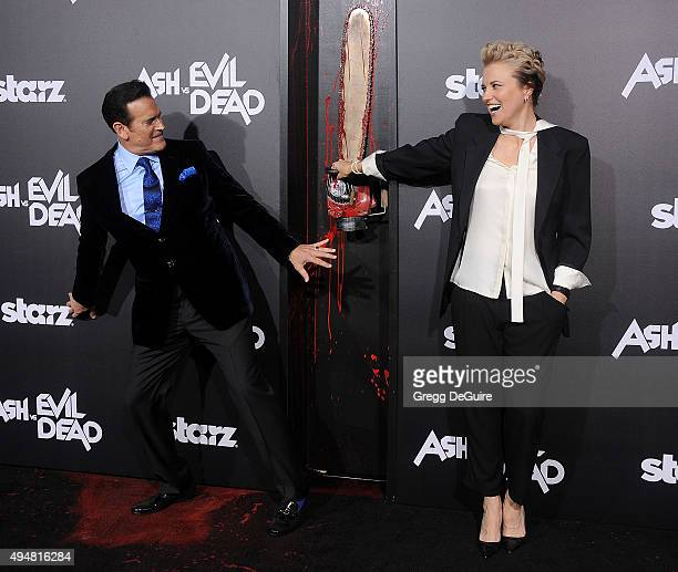 "Actors Bruce Campbell and Lucy Lawless arrive at the premiere of STARZ's ""Ash Vs Evil Dead"" at TCL Chinese Theatre on October 28, 2015 in Hollywood,..."