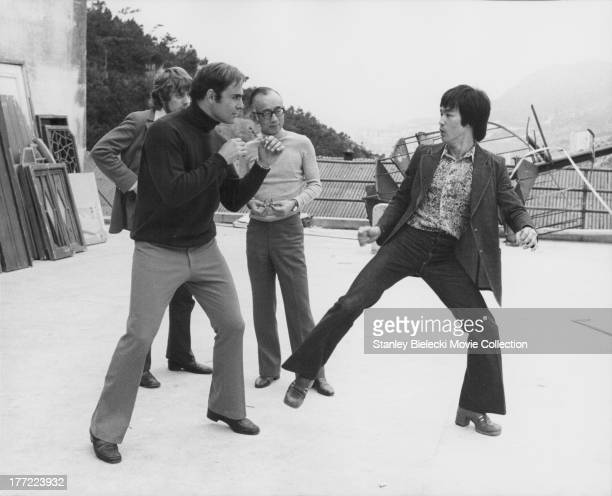 Actors Bruce Lee and John Saxon with producer Raymond Chow on the set of the movie 'Enter the Dragon' 1973