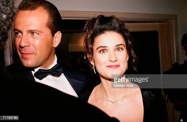 Actors Bruce Willis and Demi Moore arrive at the 1989 West Hollywood California Irving 'Swifty' Lazar Oscar Party held at Spago
