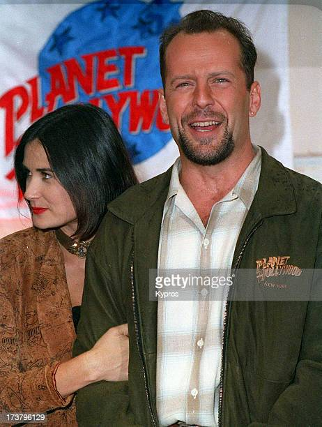 Actors Bruce Willis and Demi Moore at Planet Hollywood circa 1992