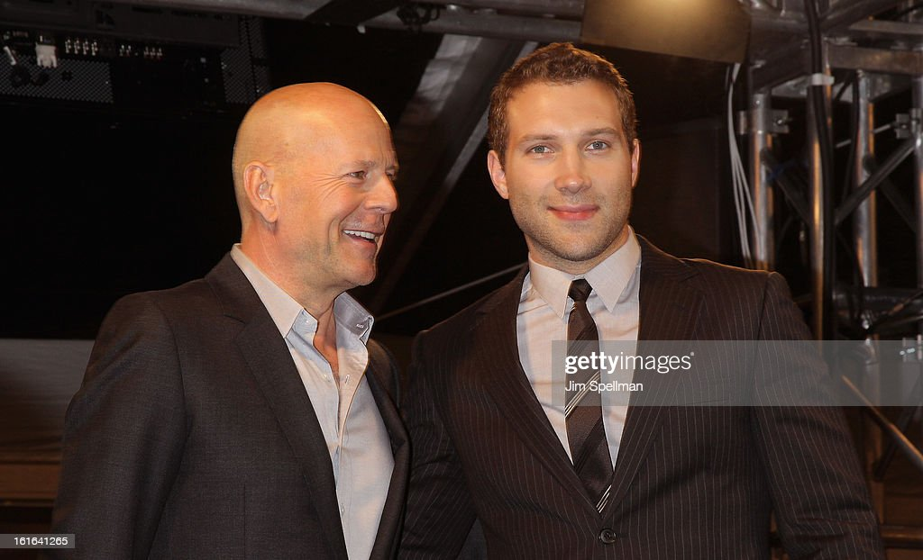 Actors Bruce Willis and Jai Courtney attend the 'A Good Day To Die Hard' Fan Celebration at AMC Empire on February 13, 2013 in New York City.
