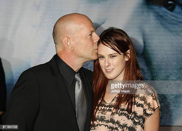 """Actors Bruce Willis and Rumer Willis arrive at the Los Angeles premiere of """"Surrogates"""" at the El Capitan Theatre on September 24, 2009 in Hollywood,..."""