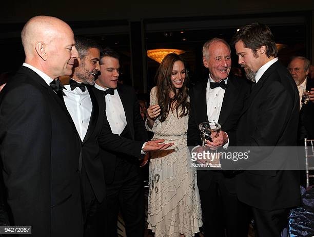 Actors Bruce Willis George Clooney Matt Damon actress Angelina Jolie Jerry Weintraub and actor Brad Pitt attend the UNICEF Ball held at the Beverly...
