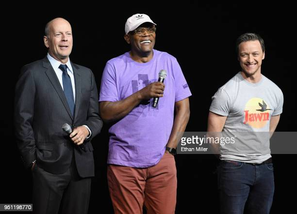 Actors Bruce Willis Samuel L Jackson and James McAvoy peaks onstage during CinemaCon 2018 Universal Pictures Invites You to a Special Presentation...