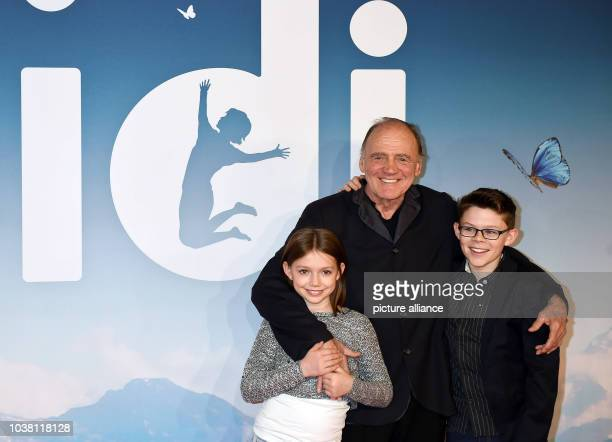 Actors Bruno Ganz Anuk Steffen and Quirin Agrippi pose on the red carpet during the German premiere of 'Heidi' in the Mathaeser Kino in...