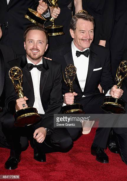 Actors Bryan Cranston and Aaron Paul pose in the press room during the 66th Annual Primetime Emmy Awards held at Nokia Theatre LA Live on August 25...