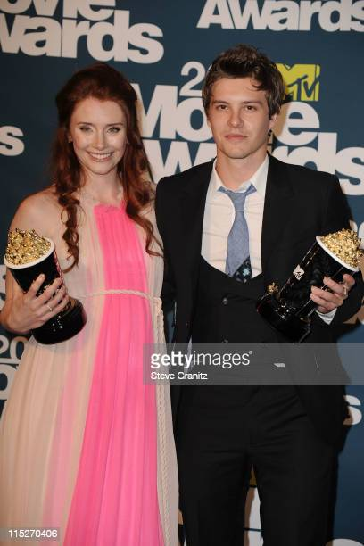 Actors Bryce Dallas Howard and Xavier Samuel pose in the press room during the 2011 MTV Movie Awards at Universal Studios' Gibson Amphitheatre on...