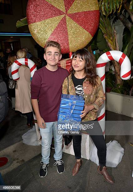 Actors Buddy Handleson Bassinger and Haley Tju attend a screening of Nickelodeon's Ho Ho Holiday Special at Paramount Studios on December 1 2015 in...