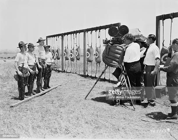 Actors Buster Keaton Cliff Edwards Victor Potel and Pitzy Katz film an army training scene for the MGM production 'Forward March' 19th May 1930