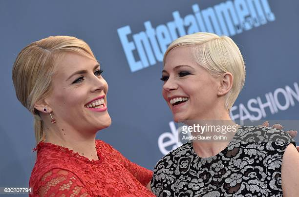 Actors Busy Philipps and Michelle Williams arrive at The 22nd Annual Critics' Choice Awards at Barker Hangar on December 11 2016 in Santa Monica...
