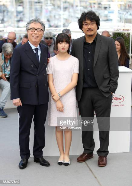 Actors Byung Heebong actress Ahn SeoHyun and director Bong JoonHo attend the 'Okja' photocall during the 70th annual Cannes Film Festival at Palais...
