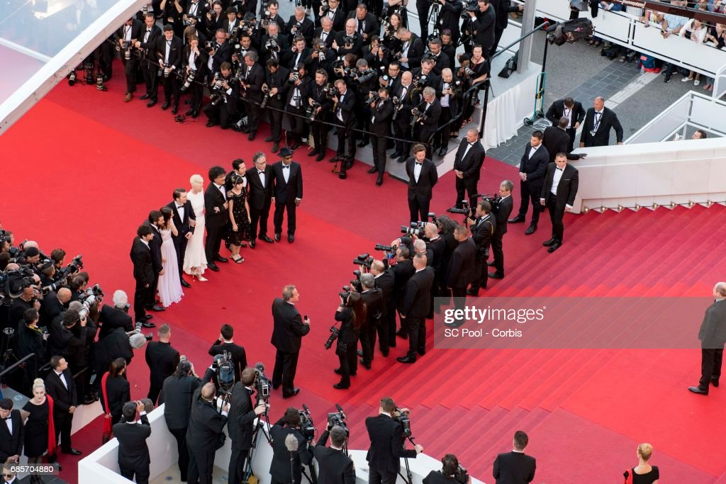 Actors Byung Heebong, Giancarlo Esposito, Ahn Seo-Hyun, Steven Yeun and Tilda Swinton, director Bong Joon-Ho and actors Paul Dano, Lily Collins, Jake Gyllenhaal and Devon Bostic attends the 'Okja' premiere during the 70th annual Cannes Film Festival at Palais des Festivals on May 19, 2017 in Cannes, France.