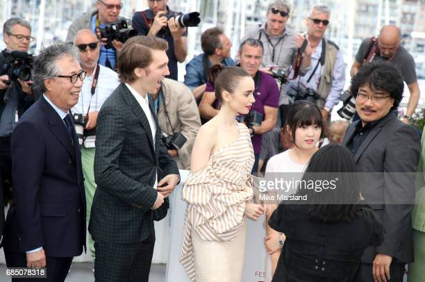 Actors Byung Heebong Paul Dano Lily Collins Ahn SeoHyun and director Bong JoonHo attend the 'Okja' photocall during the 70th annual Cannes Film...