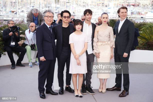Actors Byung Heebong Steven Yeun Ahn SeoHyun Devon Bostick Lily Collins and Paul Dano attend the 'Okja' photocall during the 70th annual Cannes Film...