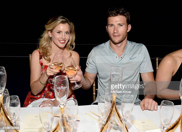 Actors Caggie Dunlop and Scott Eastwood attend The Moet and Chandon Inaugural 'Holding Court' Dinner at The 2016 BNP Paribas Open on March 19 2016 in...