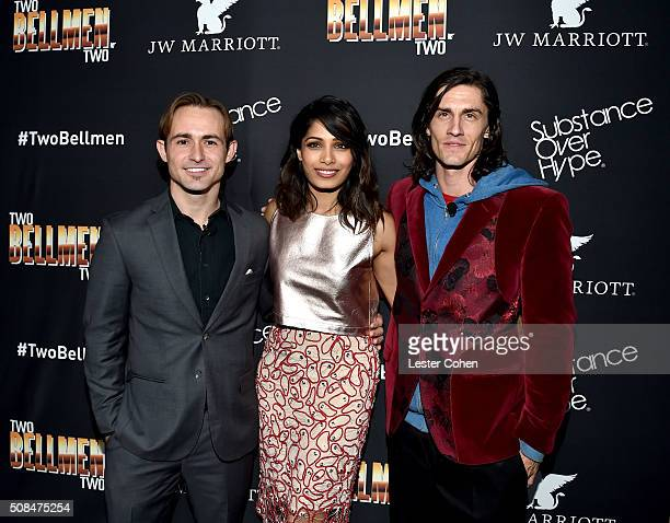 Actors Caine Sinclair Freida Pinto and William Spencer arrive at the world premiere of 'Two Bellmen Two' at JW Marriott Los Angeles at LA LIVE on...