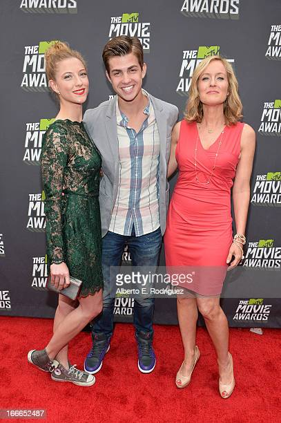 Actors Caitlin Gerard Cameron Palatas and Kari Coleman arrive at the 2013 MTV Movie Awards at Sony Pictures Studios on April 14 2013 in Culver City...