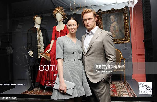 Actors Caitriona Balfe and Sam Heughan attend Saks Fifth Avenue 'Outlander' Window Display Unveiling at Saks Fifth Avenue on April 7, 2016 in New...