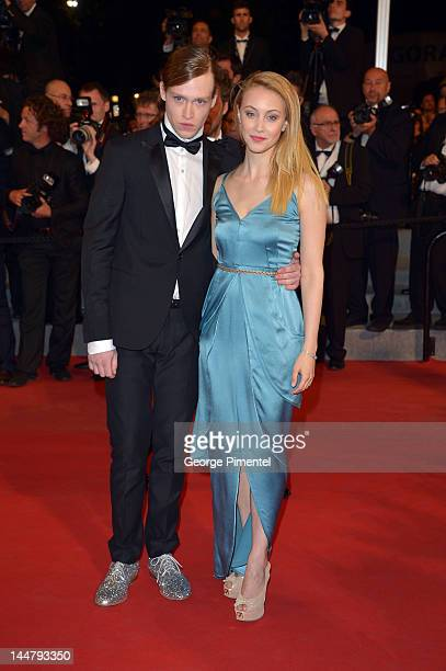 """Actors Caleb Landry Jones and Sarah Gadon walk the carpet for """"Antiviral"""" as they attend the """"The Sapphires"""" Premiere during the 65th Annual Cannes..."""