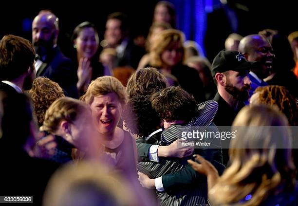 Actors Caleb McLaughlin Finn Wolfhard and Gaten Matarazzo of 'Stranger Things' embrace after winning Outstanding Performance by an Ensemble in a...