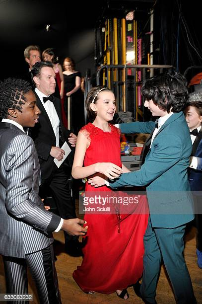 Actors Caleb McLaughlin Millie Bobby Brown and Finn Wolfhard attend The 23rd Annual Screen Actors Guild Awards at The Shrine Auditorium on January 29...