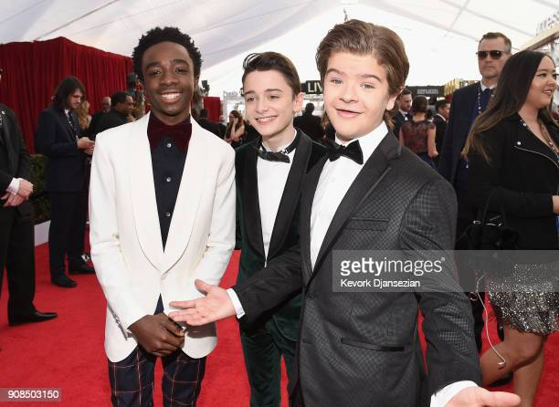 Actors Caleb McLaughlin Noah Schnapp and Gaten Matarazzo attend the 24th Annual Screen ActorsGuild Awards at The Shrine Auditorium on January 21...