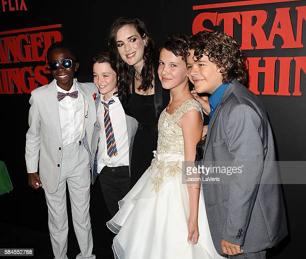 Actors Caleb McLaughlin Noah Schnapp Winona Ryder Millie Bobby Brown and Gaten Matarazzo attend the premiere of 'Stranger Things' at Mack Sennett...