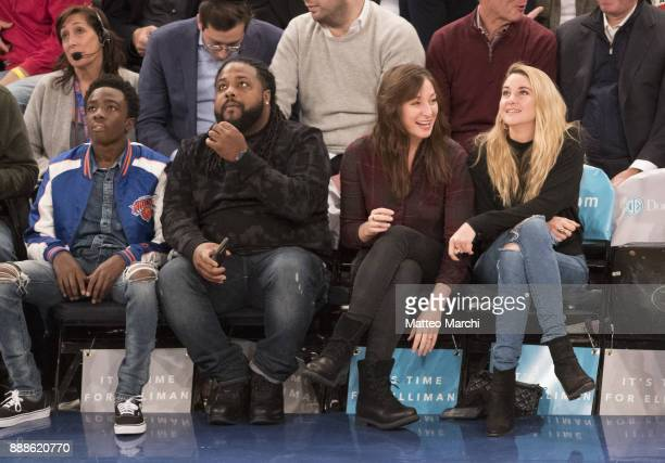 Actors Caleb McLaughlin Shailene Woodley and Isidora Goreshter watch the NBA game between the Memphis Grizzlies and the New York Knicks at Madison...