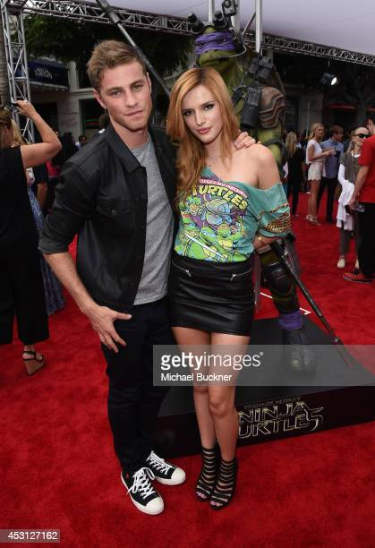 Actors Cameron Fuller and Bella Thorne attends the premiere of Paramount Pictures' Teenage Mutant Ninja Turtles at Regency Village Theatre on August...