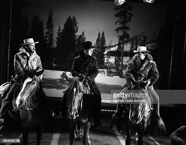 Actors Cameron Mitchell Robert Ryan and Clark Gable in a scene from the 20th Century Fox movie 'The Tall Men' circa 1955