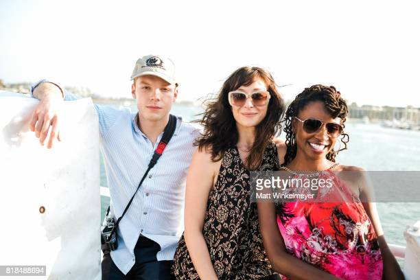 Actors Cameron Monaghan Isidora Goreshter and Shanola Hampton attend Steve Howey's Surprise 40th Birthday Party on July 16 2017 in Los Angeles...