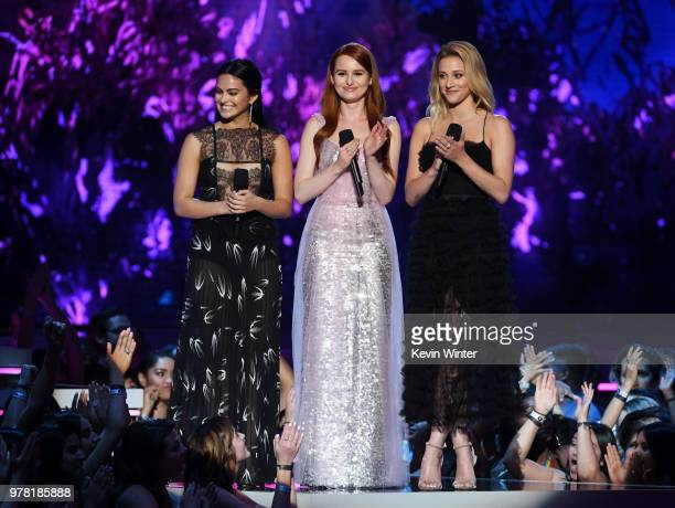 Actors Camila Mendes Madelaine Petsch and Lili Reinhart speak onstage during the 2018 MTV Movie And TV Awards at Barker Hangar on June 16 2018 in...