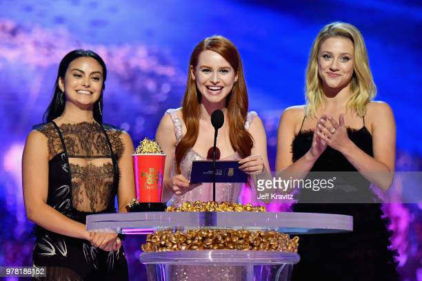 Actors Camila Mendes Madelaine Petsch and Lili Reinhart speak onstage at the 2018 MTV Movie And TV Awards at Barker Hangar on June 16 2018 in Santa...