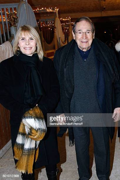 Actors Candice Patou and her husband Robert Hossein attend the 'Mario Luraschi's Espace Cavalcade' Opening Night at Ferme De La Chapelle on December...