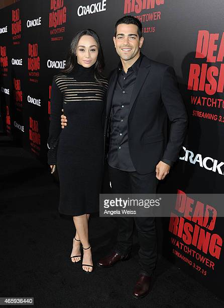 Actors Cara Santana and Jesse Metcalfe arrive at the premiere of Crackle's 'Dead Rising Watchtower' at Sony Pictures Studio on March 11 2015 in...