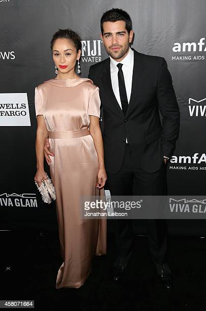 Actors Cara Santana and Jesse Metcalfe attend amfAR LA Inspiration Gala honoring Tom Ford at Milk Studios on October 29 2014 in Hollywood California