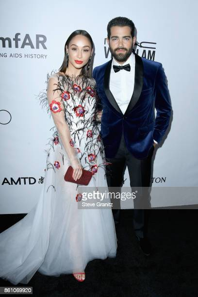 Actors Cara Santana and Jesse Metcalfe attend the amfAR Gala 2017 at Ron Burkle's Green Acres Estate on October 13 2017 in Beverly Hills California