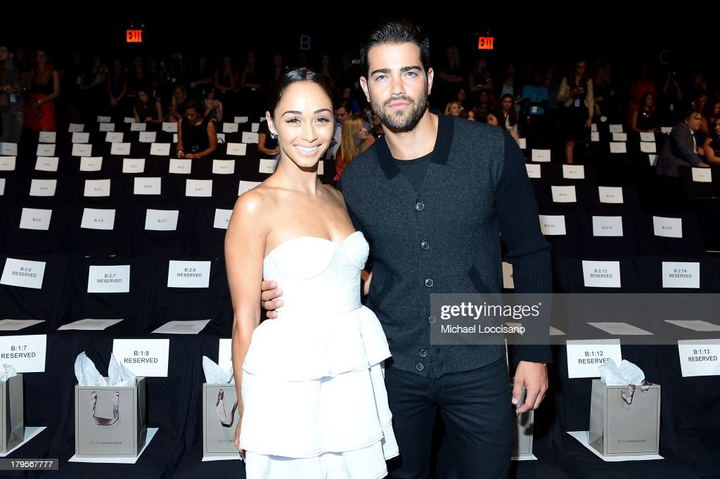 Actors Cara Santana (L) and Jesse Metcalfe attend the BCBGMAXAZRIA Spring 2014 fashion show during Mercedes-Benz Fashion Week at The Theatre at Lincoln Center on September 5, 2013 in New York City.