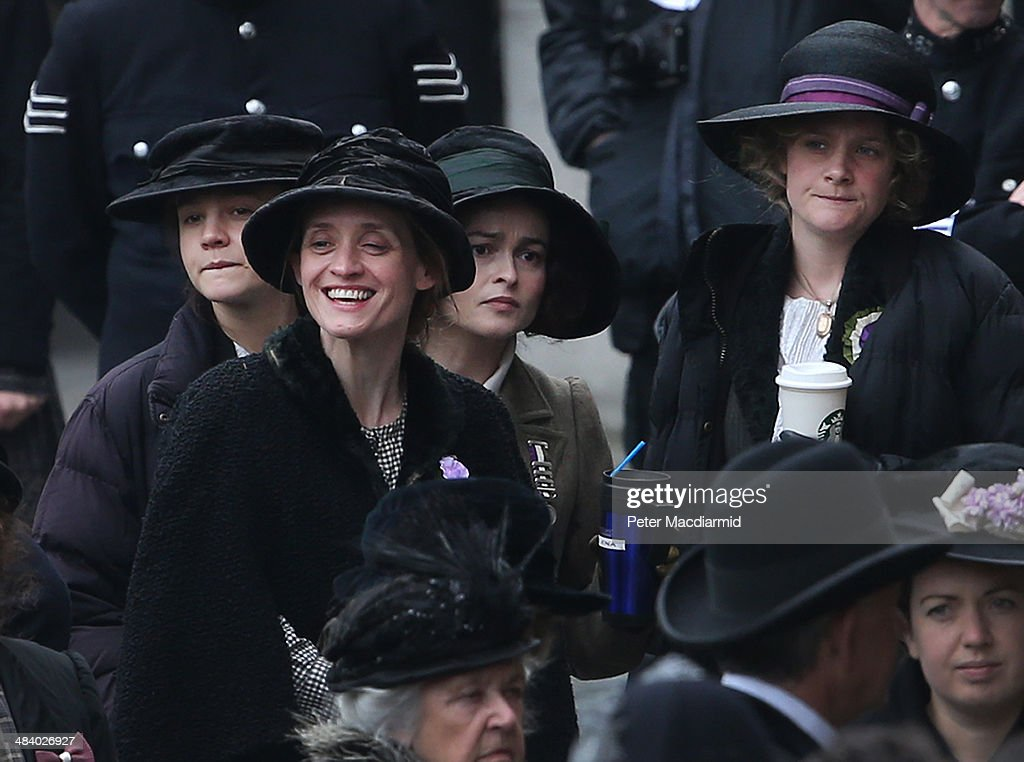 Actors (L-R) Carey Mulligan, Anne-Marie Duff, Helena Bonham Carter and Romola Garai keep warm during a break in filming of the movie Suffragette at Parliament on April 11, 2014 in London, England. This is the first time filming for a movie has been allowed in The Houses of Parliament. Suffragette is due for release in 2015.