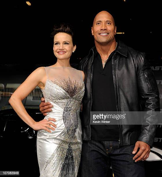 "Actors Carla Gugino and Dwayne Johnson arrive at the premiere of CBS Films' ""Faster"" at the Chinese Theater on November 22, 2010 in Los Angeles,..."