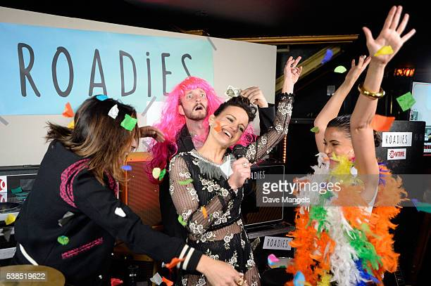 "Actors Carla Gugino and Emmanuelle Chriqui pose in the photo booth during the after party for Showtime's ""Roadies"" at The Theatre at Ace Hotel on..."