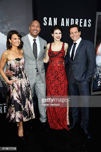 Actors Carla Gugino Dwayne 'The Rock' Johnson Alexandra Daddario and Ioan Gruffudd attend the premiere of Warner Bros Pictures' 'San Andreas' at the...
