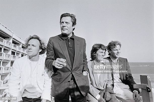 Actors Carlo Giuffre, Marcello Mastroianni, and Ken Marshall, with director Liliana Cavani, attend the Cannes Film Festival. They promoted their 1981...