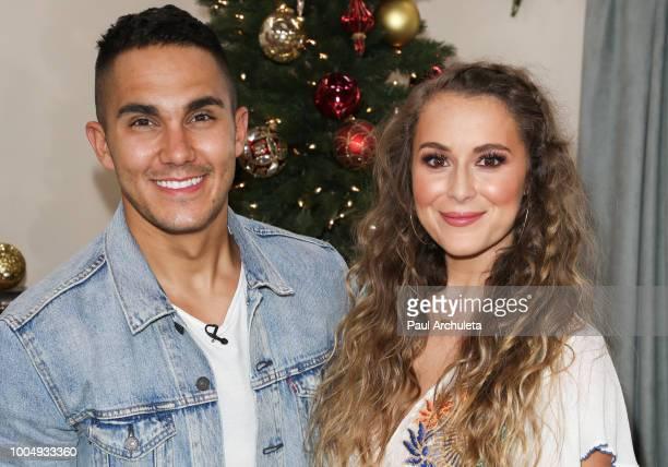 Actors Carlos PenaVega and Alexa PenaVega visit Hallmark's 'Home Family' celebrating 'Christmas In July' at Universal Studios Hollywood on July 24...