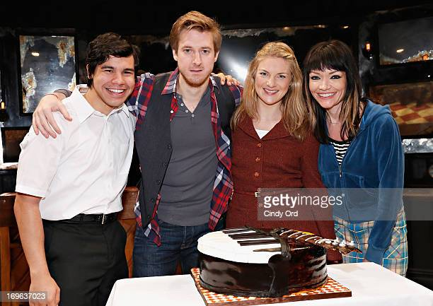 Actors Carlos Valdes Arthur Darvill Joanna Christie and Katrina Lenk pose with a cake presented to the cast as ONCE on Broadway Celebrates 500...