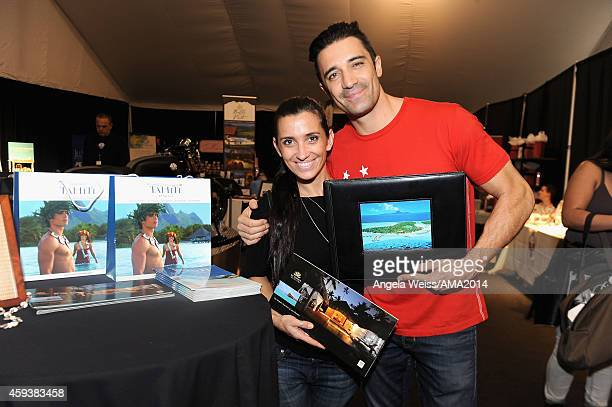 Actors Carole Marini and Gilles Marini attend the 2014 American Music Awards UPS Gifting Suite at Nokia Theatre LA Live on November 21 2014 in Los...