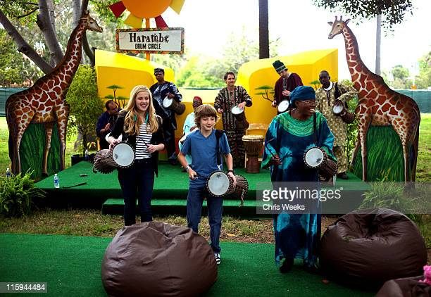 Actors Caroline Sunshine and Jake Short play along with the Harambe Drum Circle during the 22nd Annual Time for Heroes Celebrity Picnic sponsored by...
