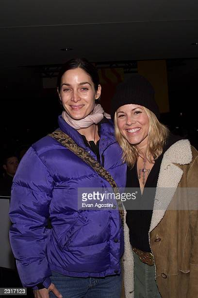 Actors Carrie Ann Moss and Maria Bello arriving at the premiere of 'The Good Girl' during the 2002 Sundance Film Festival in Park City Utah 1/12/2002...