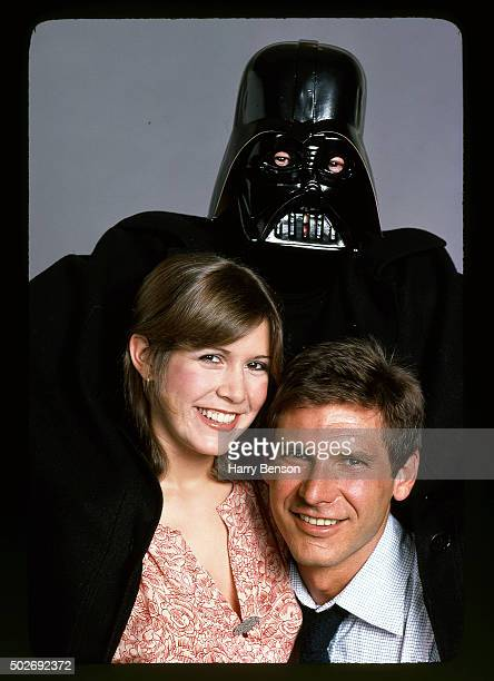 Actors Carrie Fisher and Harrison Ford are photographed with Darth Vader for People Magazine in 1978 in New York City